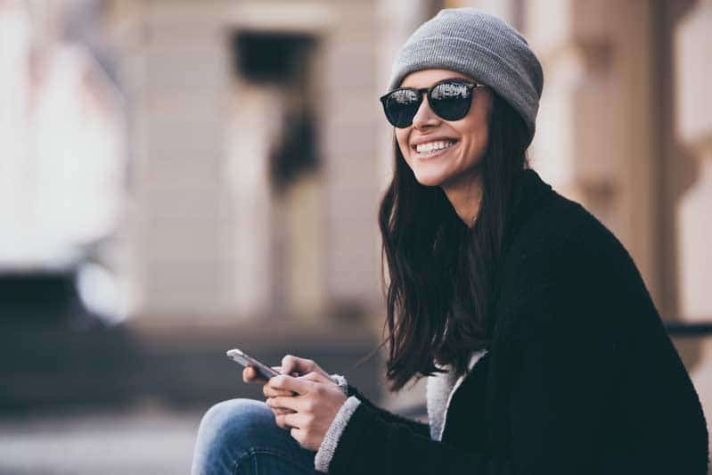 Girl outside with sunglasses smiling