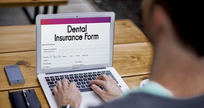 Man filling the Dental Insurance form
