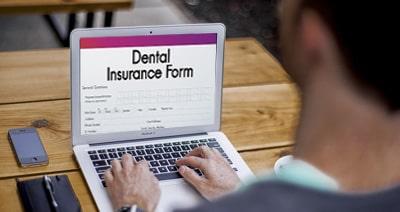 Man filling the Dental Insurance form
