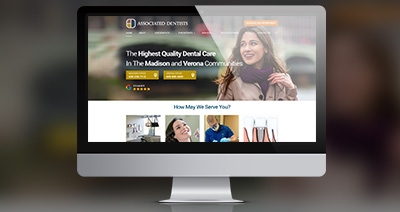The Associated Dentists website on a computer