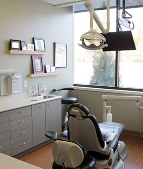 Dental chair with equipment and display screen
