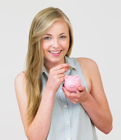 Teenage Girl Putting Money Into Piggy Bank