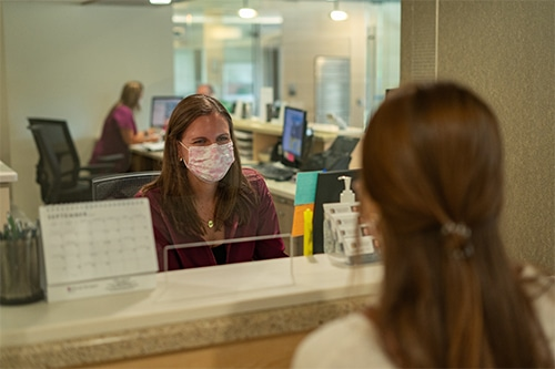 Patient investigating a receptionist